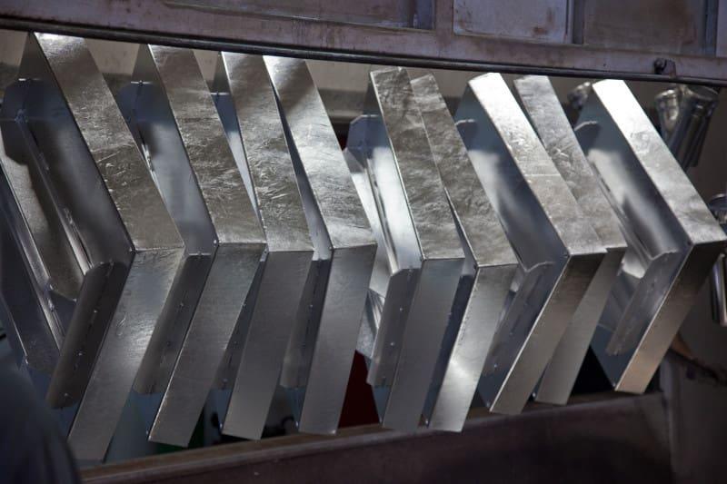 Rack plating of larger metal machine pieces